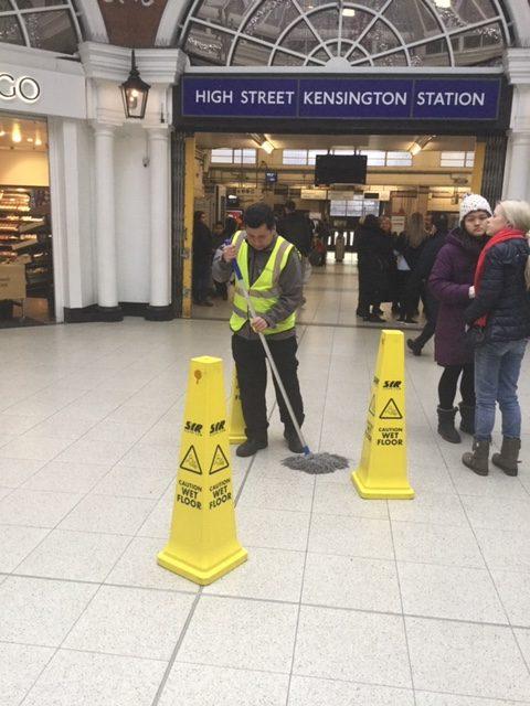 Cleaner outside Kensington station